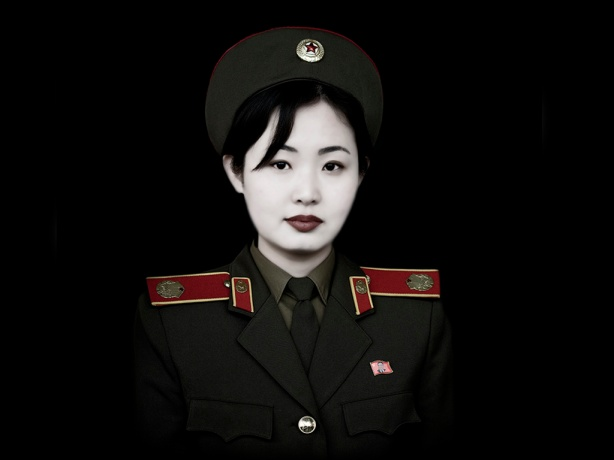 Kim, a young french military speaking guide at the Army Museum. Women may represent more than 10 percent of the entire North Korean People's Army. North Korea is the most militarised country in the world.According to the US State Department, North Korea has the 4th largest military in the world, at an estimated 1.2 million armed personnel for 23 millions north koreans. Even if many think NK has nuclear bomb, the guns, cars, military equipment seems to come from the 50's... The Korean People's Army is the military of North Korea. Kim Jong Il is the Supreme Commander of the Korean People's Army . The famous Bush's Axis of evil includes Iran, Iraq, and North Korea. In NK, every young man stay for 6 years in the Army. It means that for 6 years, he won't have many news from his families because there is no email, mobile and very few private phones in North Korea. La Coree du Nord est le pays le plus militarisé du monde. Ils possederairent la 4eme armée du monde, avec 1,2 million de personnels armés pour 23 millions d'habitants. Le pays possederait la bombe nucleaire, mais son materiel militaire ressemble à celui en circulation dans les années 50. La Coree du Nord fait partie de l'axe du mal denonce par George Bush. En Coree du Nord,le service militaire est obligatoire , dure environs 6 ans, ce qui coupe completement la recrue de sa famille pour une longue diree en raison du manque de moyens de communication: pas de mobile, pas de mail, pas de telephone privé...